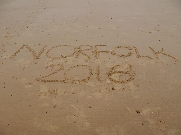 Norfolk written in the sand
