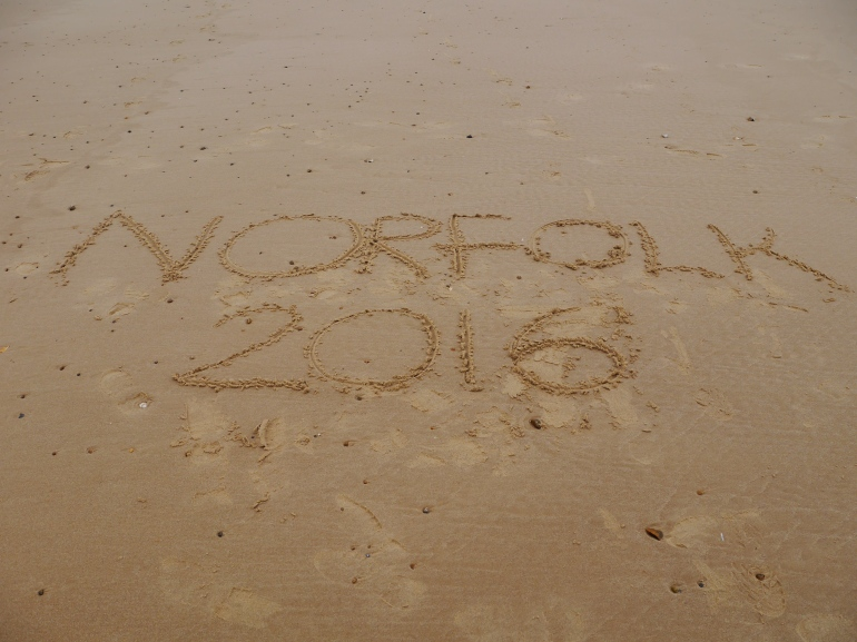 Norfolk written in the sand
