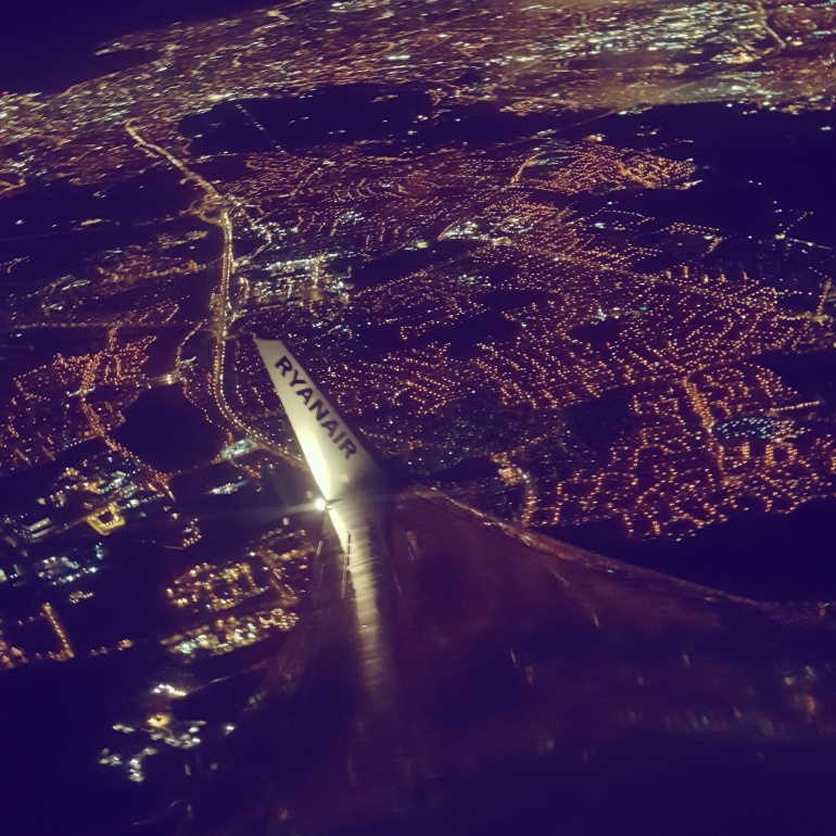 Nighttime view over London from plane