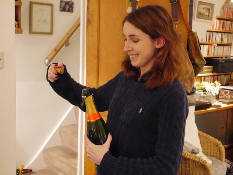 Blogger Opening Prosecco Bottle