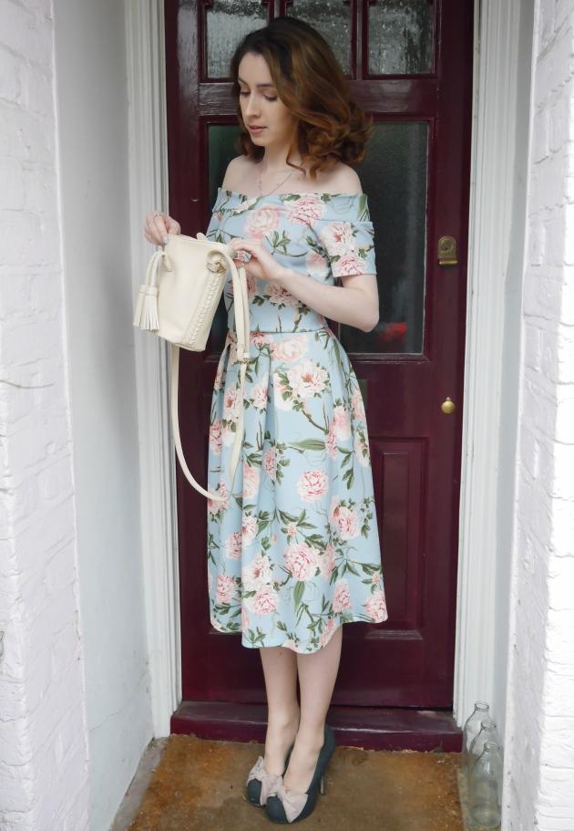 Blogger looking in handbag at wedding