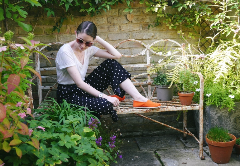 Blogger sitting on bench wearing colour pop shoes