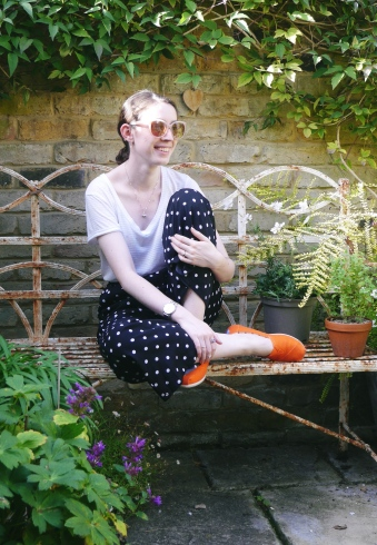 Blogger laughing on a bench